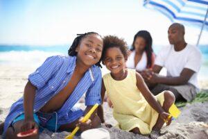 family enjoying time at the beach