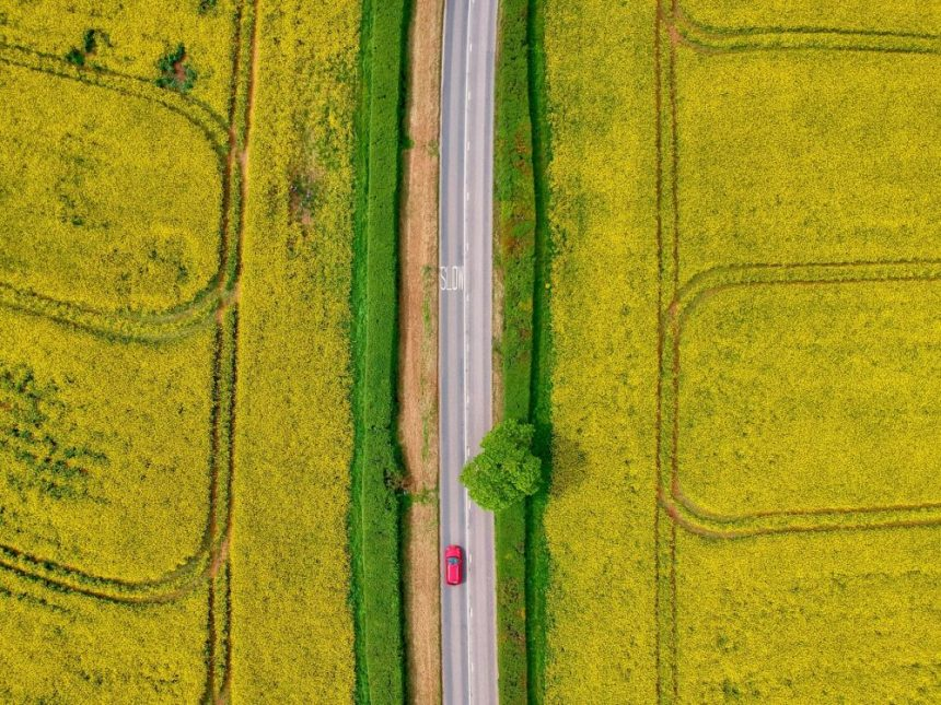 Red Zeppelin - aerial view of car driving on road